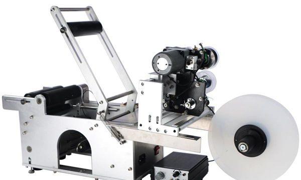 Halvautomatisk maskin for rund flaske